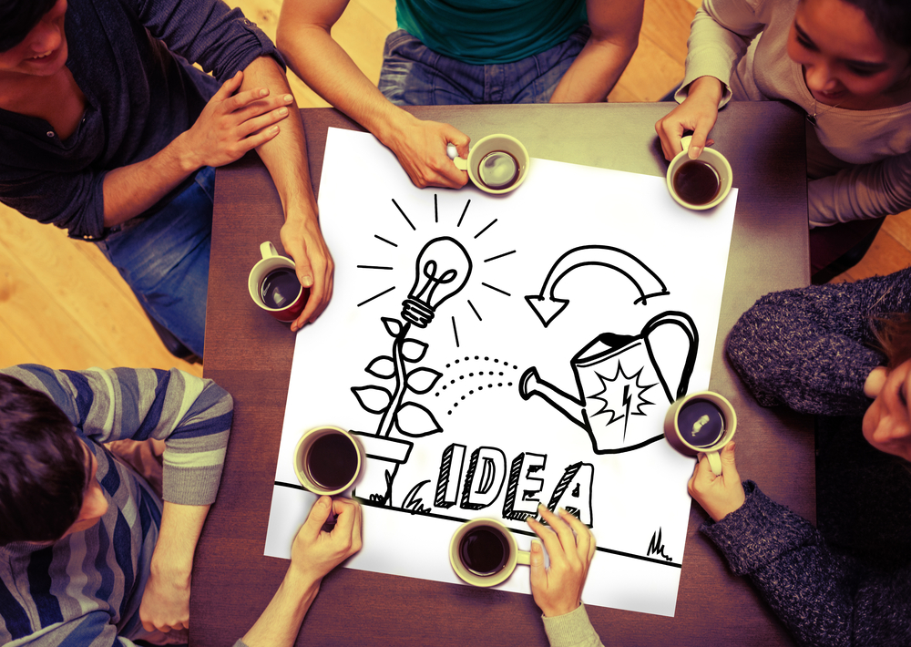 Composite image of idea and innovation graphic on page with people sitting around table drinking coffee