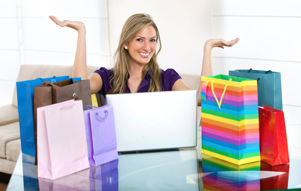 Woman portrait smiling shopping online with bags